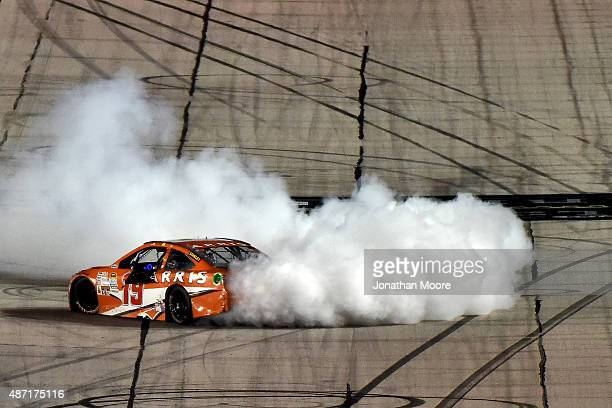 Carl Edwards driver of the ARRIS Toyota celebrates with a burnout after winning the NASCAR Sprint Cup Series Bojangles' Southern 500 at Darlington...