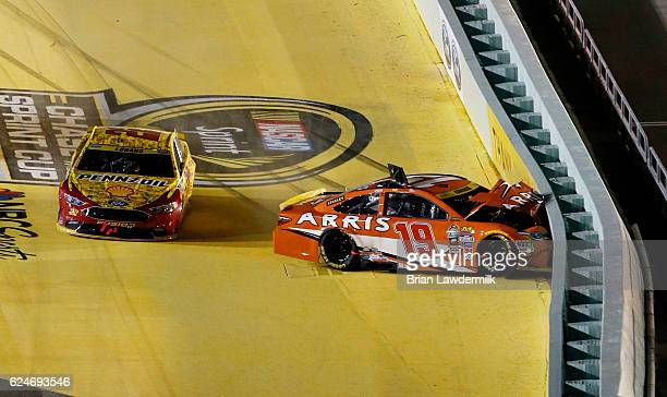 Carl Edwards driver of the ARRIS Toyota is involved in an ontrack incident after making contact with Joey Logano driver of the Shell Pennzoil Ford...