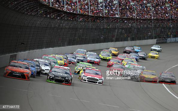 Carl Edwards driver of the ARRIS Toyota Kasey Kahne driver of the Great Clips Chevrolet and Ryan Blaney driver of the Motorcraft/Quick Lane Tire Auto...