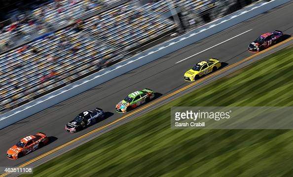 Carl Edwards driver of the Arris Toyota leads a pack of cars during qualifying for the 57th Annual Daytona 500 at Daytona International Speedway on...