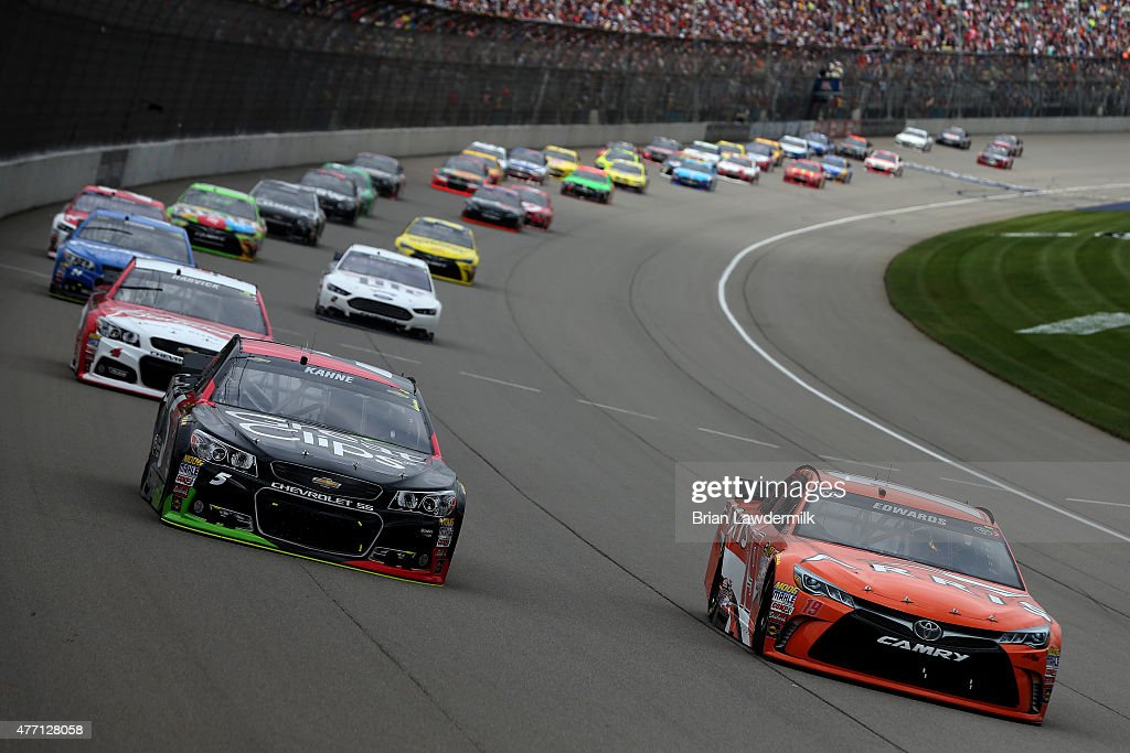 Carl Edwards driver of the ARRIS Toyota passes Kasey Kahne driver of the Great Clips Chevrolet for the lead during the NASCAR Sprint Cup Series...