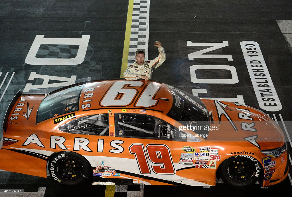 <a gi-track='captionPersonalityLinkClicked' href=/galleries/search?phrase=Carl+Edwards&family=editorial&specificpeople=193803 ng-click='$event.stopPropagation()'>Carl Edwards</a>, driver of the #19 ARRIS Toyota, salutes the crowd after winning the NASCAR Sprint Cup Series Bojangles' Southern 500 at Darlington Raceway on September 6, 2015 in Darlington, South Carolina.