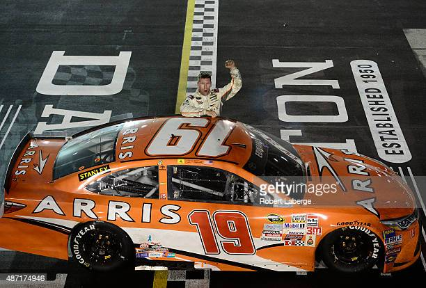 Carl Edwards driver of the ARRIS Toyota salutes the crowd after winning the NASCAR Sprint Cup Series Bojangles' Southern 500 at Darlington Raceway on...