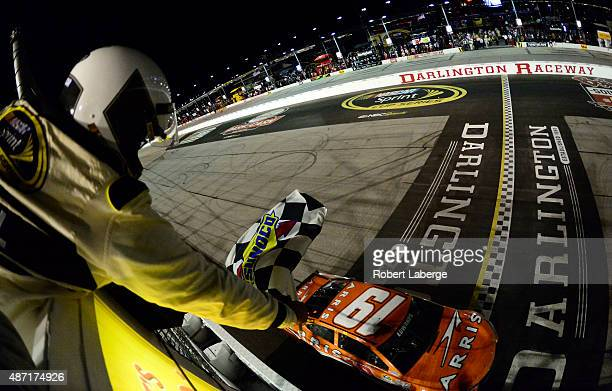 Carl Edwards driver of the ARRIS Toyota takes the checkered flag to win the NASCAR Sprint Cup Series Bojangles' Southern 500 at Darlington Raceway on...