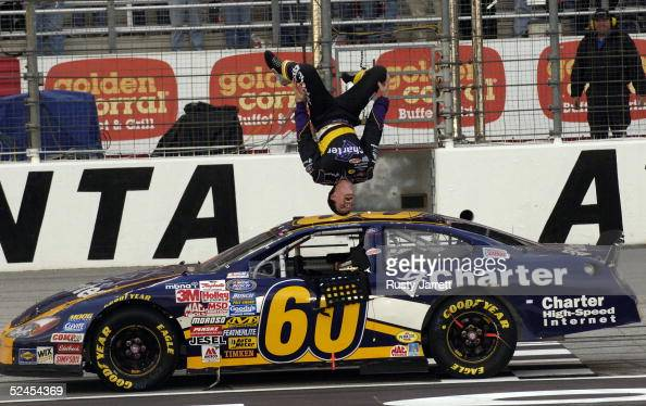 Carl Edwards driver of the Charter Communications Ford does a backflip after winning the NASCAR Busch Series Aaron's 312 on March 19 2005 at the...