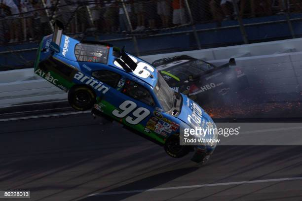 Carl Edwards driver of the Claritin Ford goes airborne as Ryan Newman driver of the StewartHaas Racing Chevrolet hits the wall at the end of the...