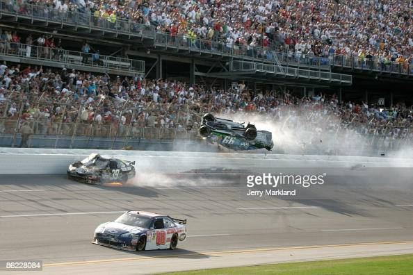 Carl Edwards driver of the Claritin Ford goes airborne as Ryan Newman driver of the SteweartHaas Racing Chevrolet suffers damage and Dale Earnhardt...