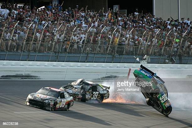 Carl Edwards driver of the Claritin Ford goes airborne as Ryan Newman driver of the SteweartHaas Racing Chevrolet suffers damage and Brad Keselowski...