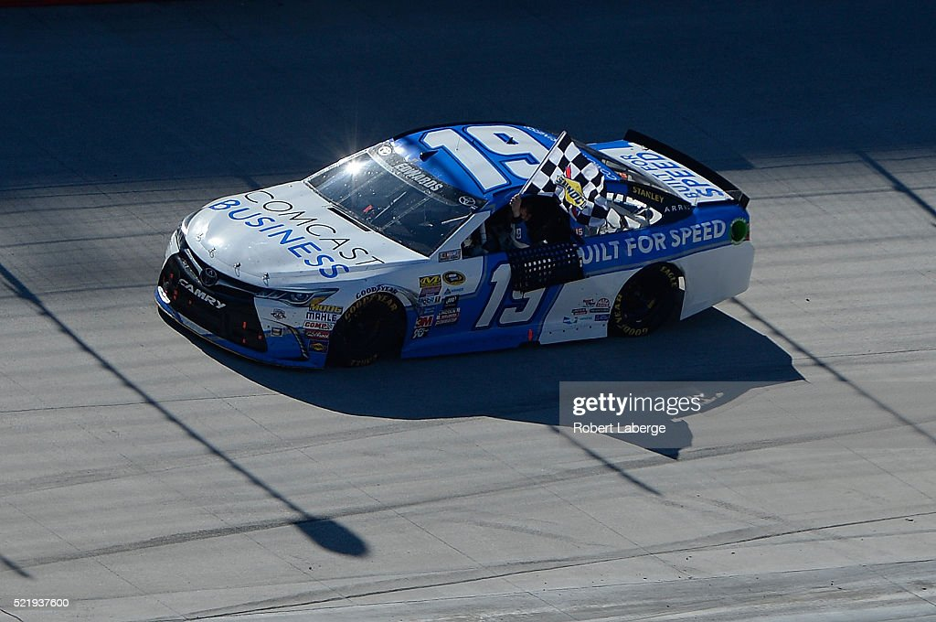 Carl Edwards driver of the Comcast Business Toyota celebrates after winning the NASCAR Sprint Cup Series Food City 500 at Bristol Motor Speedway on...