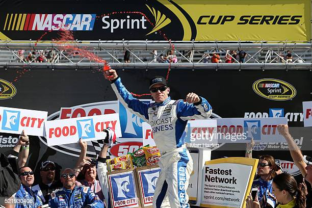 Carl Edwards driver of the Comcast Business Toyota celebrates in Victory Lane after winning the NASCAR Sprint Cup Series Food City 500 at Bristol...