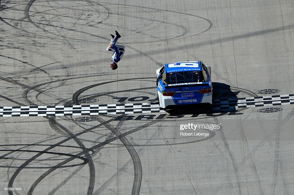Carl Edwards driver of the Comcast Business Toyota celebrates winning the NASCAR Sprint Cup Series Food City 500 at Bristol Motor Speedway on April...