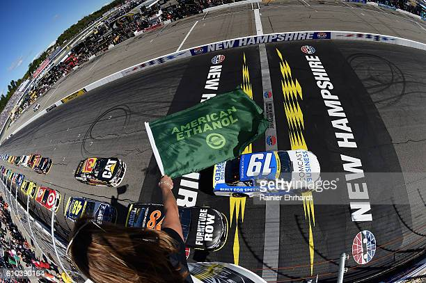 Carl Edwards driver of the Comcast Business Toyota leads the field to the green flag during the NASCAR Sprint Cup Series Bad Boy Off Road 300 at New...