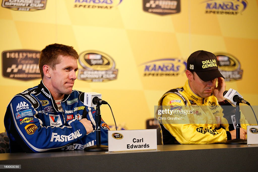 <a gi-track='captionPersonalityLinkClicked' href=/galleries/search?phrase=Carl+Edwards&family=editorial&specificpeople=193803 ng-click='$event.stopPropagation()'>Carl Edwards</a>, driver of the #99 Fastenal Ford, and <a gi-track='captionPersonalityLinkClicked' href=/galleries/search?phrase=Matt+Kenseth&family=editorial&specificpeople=204192 ng-click='$event.stopPropagation()'>Matt Kenseth</a>, driver of the #20 Dollar General Toyota, talk with the media following testing for the NASCAR Sprint Cup Series at Kansas Speedway on October 3, 2013 in Kansas City, Kansas.