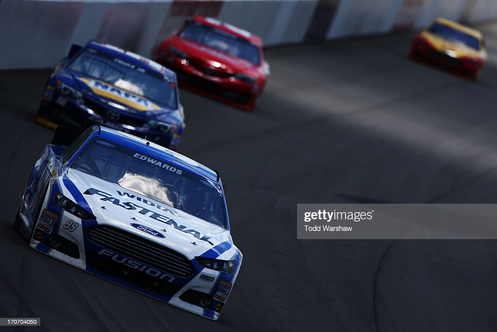 Carl Edwards, driver of the #99 Fastenal Ford, leads a group of cars during the NASCAR Sprint Cup Series Quicken Loans 400 at Michigan International Speedway on June 16, 2013 in Brooklyn, Michigan.
