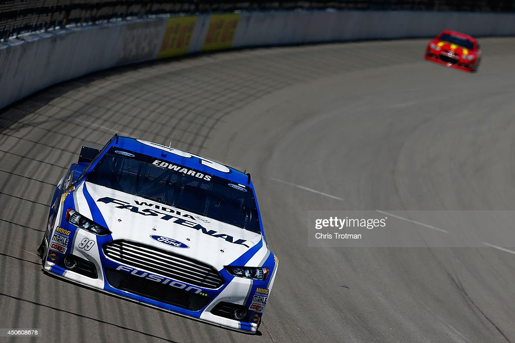 Carl Edwards, driver of the #99 Fastenal Ford, leads Jamie McMurray, driver of the #1 McDonald's Chevrolet, during practice for the NASCAR Sprint Cup Series Quicken Loans 400 at Michigan International Speedway on June 14, 2014 in Brooklyn, Michigan.