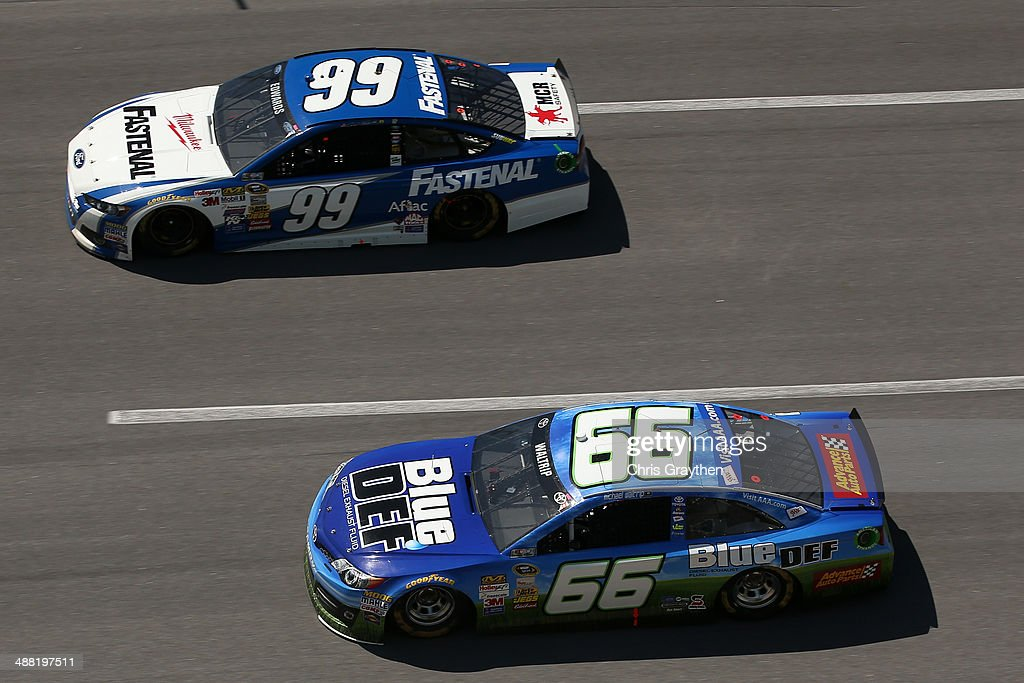 Carl Edwards, driver of the #99 Fastenal Ford, leads Michael Waltrip, driver of the #66 Blue / DEF Toyota, during the NASCAR Sprint Cup Series Aaron's 499 at Talladega Superspeedway on May 4, 2014 in Talladega, Alabama.