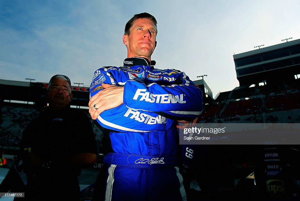 <a gi-track='captionPersonalityLinkClicked' href=/galleries/search?phrase=Carl+Edwards&family=editorial&specificpeople=193803 ng-click='$event.stopPropagation()'>Carl Edwards</a>, driver of the #99 Fastenal Ford, looks on after qualifying for the NASCAR Sprint Cup Series IRWIN Tools Night Race at Bristol Motor Speedway on August 23, 2013 in Bristol, Tennessee.
