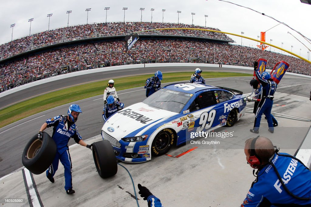 Carl Edwards, driver of the #99 Fastenal Ford, pits during the NASCAR Sprint Cup Series Daytona 500 at Daytona International Speedway on February 24, 2013 in Daytona Beach, Florida.