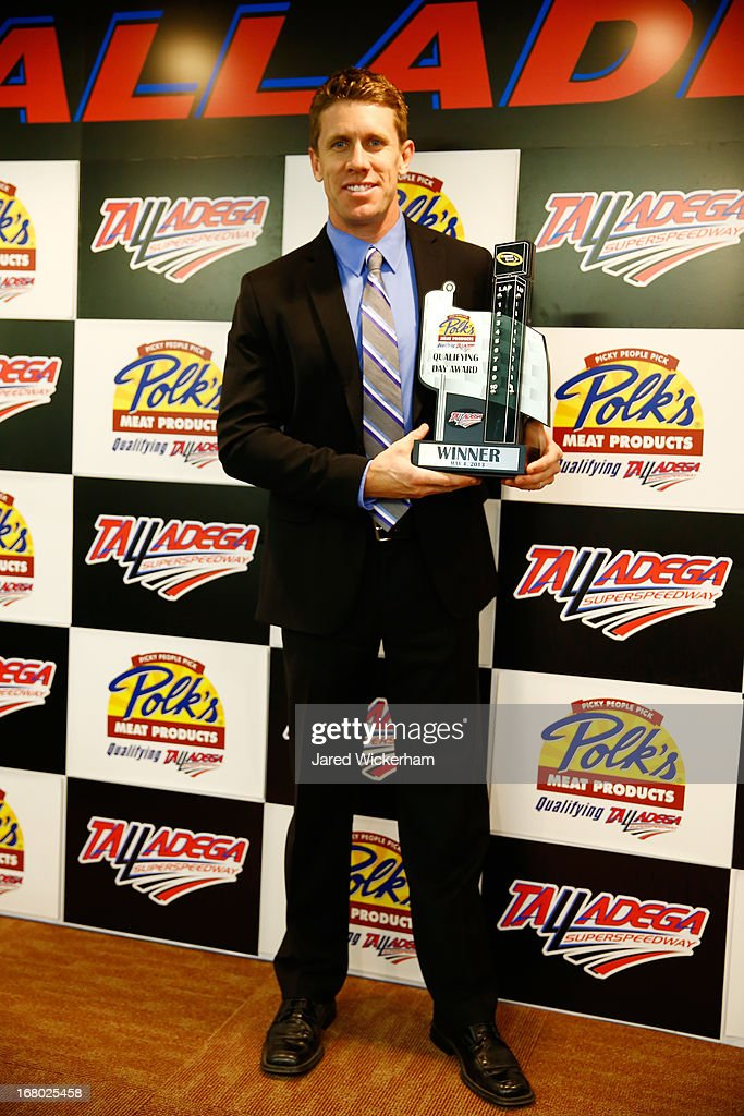 <a gi-track='captionPersonalityLinkClicked' href=/galleries/search?phrase=Carl+Edwards&family=editorial&specificpeople=193803 ng-click='$event.stopPropagation()'>Carl Edwards</a>, driver of the #99 Fastenal Ford, poses with his pole award during qualifying for the NASCAR Sprint Cup Series Aaron's 499 at Talladega Superspeedway on May 4, 2013 in Talladega, Alabama. Edwards was awarded the pole based off of his practice lap time due to qualifying being canceled due to inclimate weather.