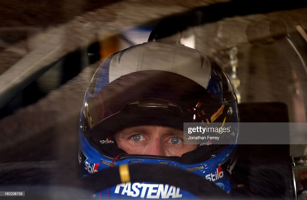 Carl Edwards, driver of the #99 Fastenal Ford, sits in his car during practice for the NASCAR Sprint Cup Series Daytona 500 at Daytona International Speedway on February 20, 2013 in Daytona Beach, Florida.