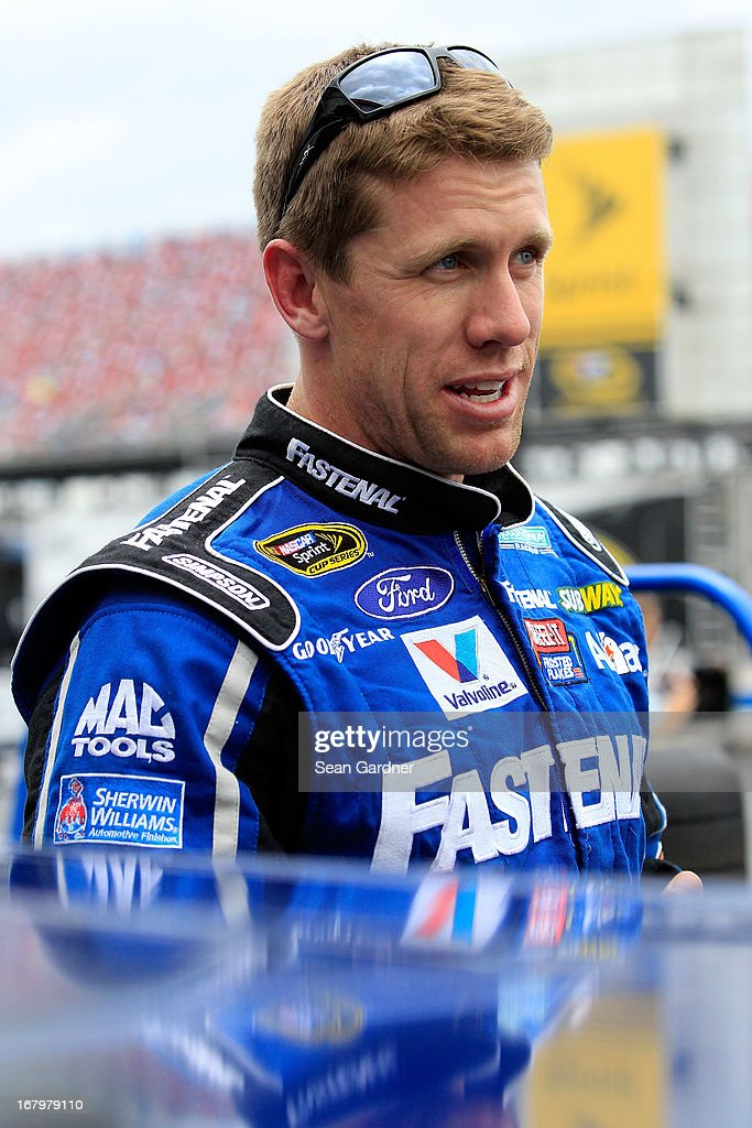 Carl Edwards, driver of the #99 Fastenal Ford, stands in the garage area during practice for the NASCAR Sprint Cup Series Aaron's 499 at Talladega Superspeedway on May 3, 2013 in Talladega, Alabama.