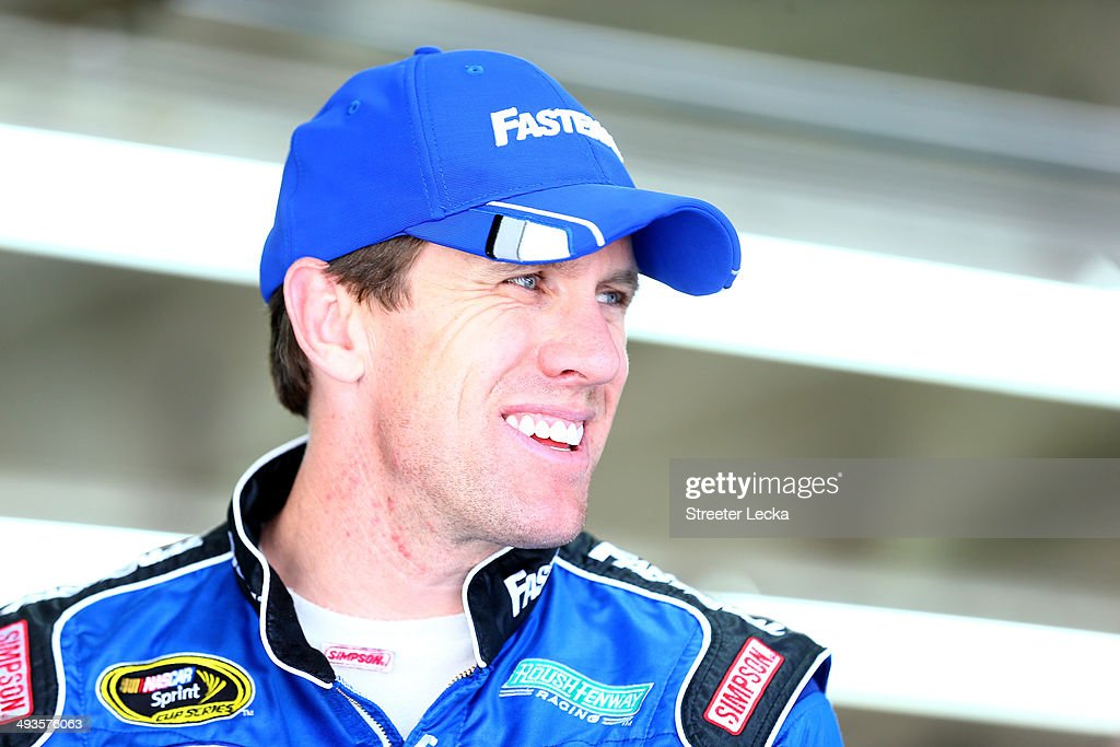 Carl Edwards, driver of the #99 Fastenal Ford, stands in the garage area during practice for the NASCAR Sprint Cup Series Coca-Cola 600 at Charlotte Motor Speedway on May 24, 2014 in Charlotte, North Carolina.