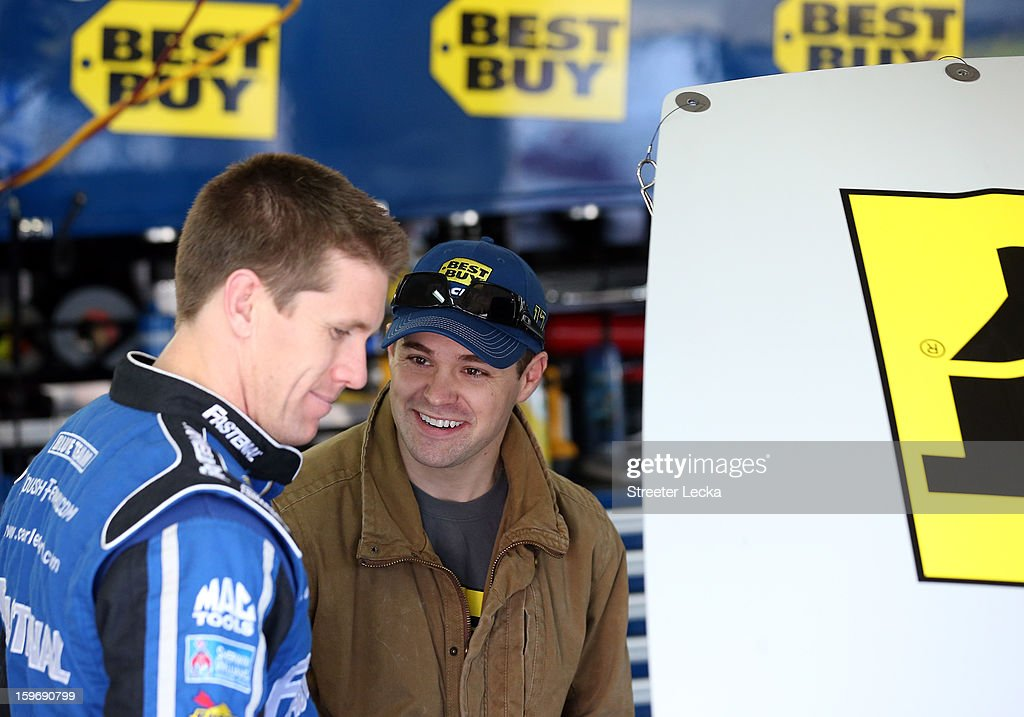 Carl Edwards, driver of the #99 Fastenal, talks to Ricky Stenhouse Jr., driver of the #17 Best Buy, during NASCAR Testing at Charlotte Motor Speedway on January 18, 2013 in Charlotte, North Carolina.