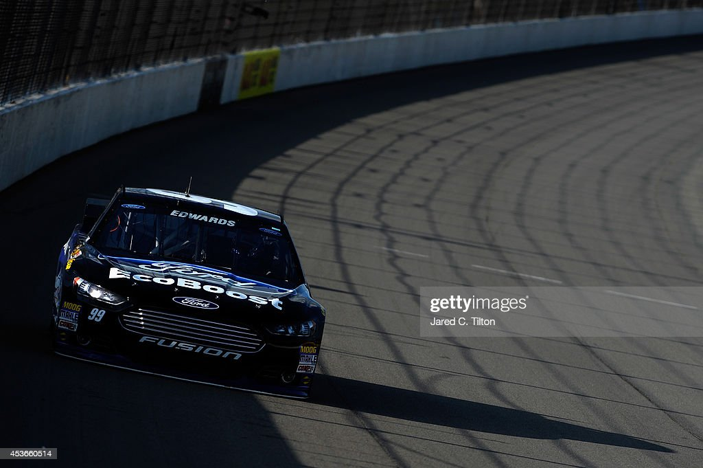 Carl Edwards, driver of the #99 Ford EcoBoost Ford, qualifies for the NASCAR Sprint Cup Series Pure Michigan 400 at Michigan International Speedway on August 15, 2014 in Brooklyn, Michigan.