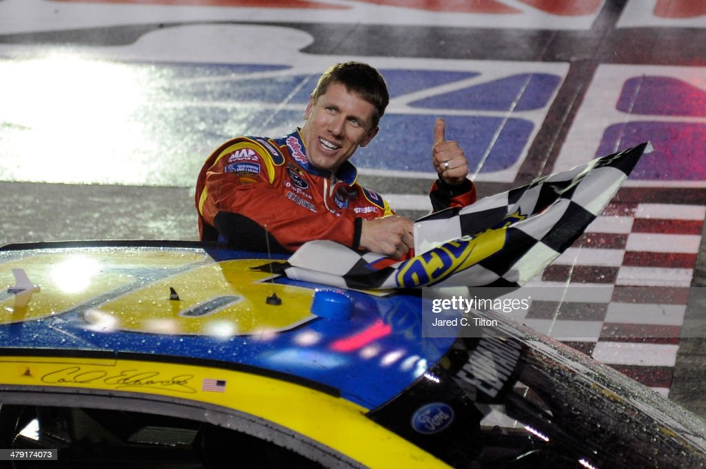 <a gi-track='captionPersonalityLinkClicked' href=/galleries/search?phrase=Carl+Edwards&family=editorial&specificpeople=193803 ng-click='$event.stopPropagation()'>Carl Edwards</a>, driver of the #99 Kellogg's / Frosted Flakes Ford Ford, celebrates with the checkered flag after winning the NASCAR Sprint Cup Series Food City 500 at Bristol Motor Speedway on March 16, 2014 in Bristol, Tennessee.