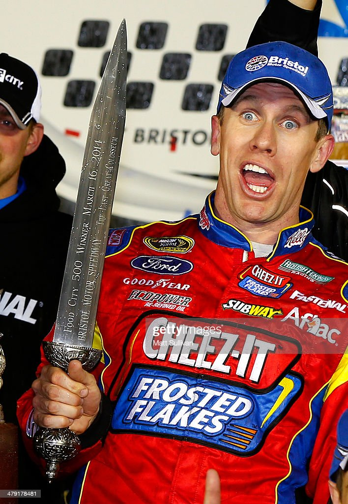 Carl Edwards, driver of the #99 Kellogg's / Frosted Flakes Ford, poses in Victory Lane after the NASCAR Sprint Cup Series Food City 500 at Bristol Motor Speedway on March 16, 2014 in Bristol, Tennessee.
