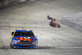 Carl Edwards driver of the Kellogg's/Frosted Flakes Ford celebrates with a backflip after winning the NASCAR Sprint Cup Series Food City 500 at...
