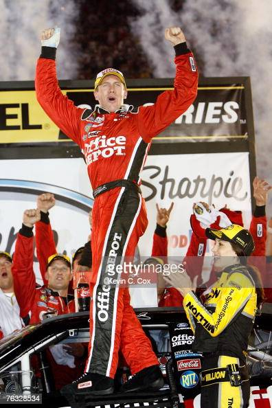 Carl Edwards driver of the Office Depot Ford celebrates with his team after winning the NASCAR Nextel Cup Series Sharpie 500 at Bristol Motor...