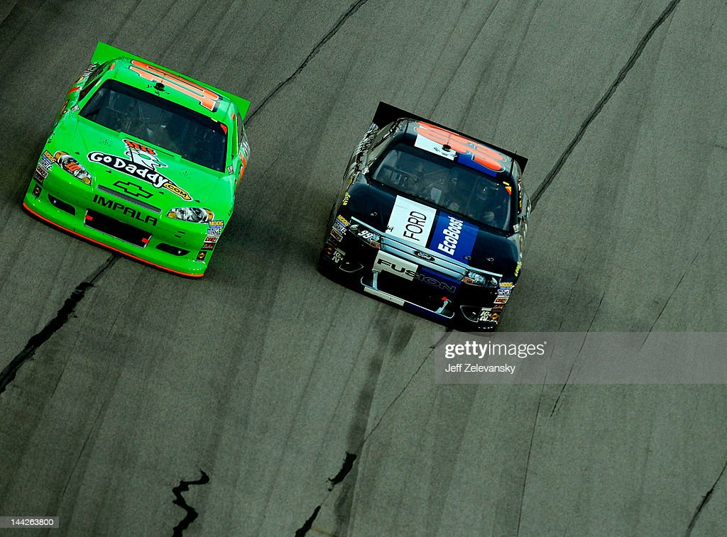 Carl Edwards, driver of the #99 Roush Fenway Racing Ford, races with Danica Patrick, driver of the #10 GoDaddy.com Chevrolet, during the NASCAR Sprint Cup Series Bojangles' Southern 500 at Darlington Raceway on May 12, 2012 in Darlington, South Carolina.