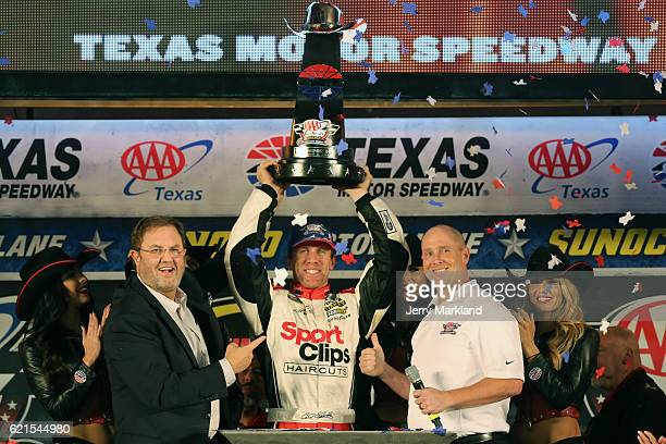 Carl Edwards driver of the Sport Clips Toyota celebrates in Victory Lane with Texas Motor Speedway President Eddie Gossage after winning the...