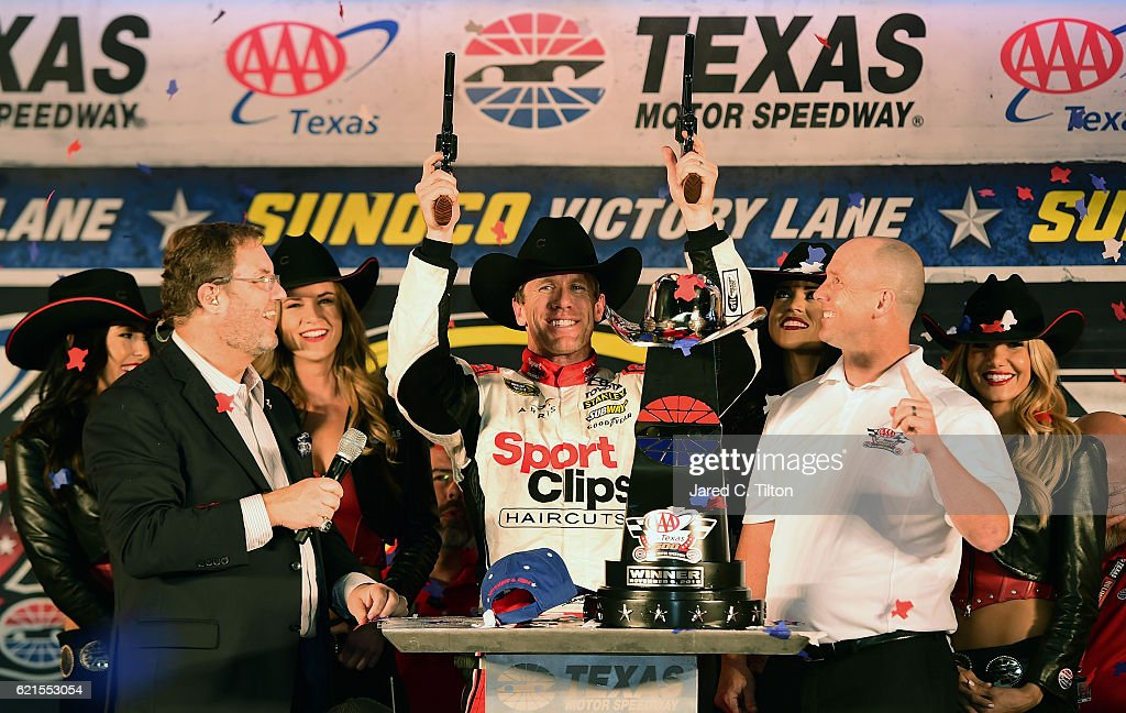 Carl Edwards, driver of the #19 Sport Clips Toyota, celebrates in Victory Lane with Texas Motor Speedway President Eddie Gossage after winning the rain-shortened NASCAR Sprint Cup Series AAA Texas 500 at Texas Motor Speedway on November 6, 2016 in Fort Worth, Texas.