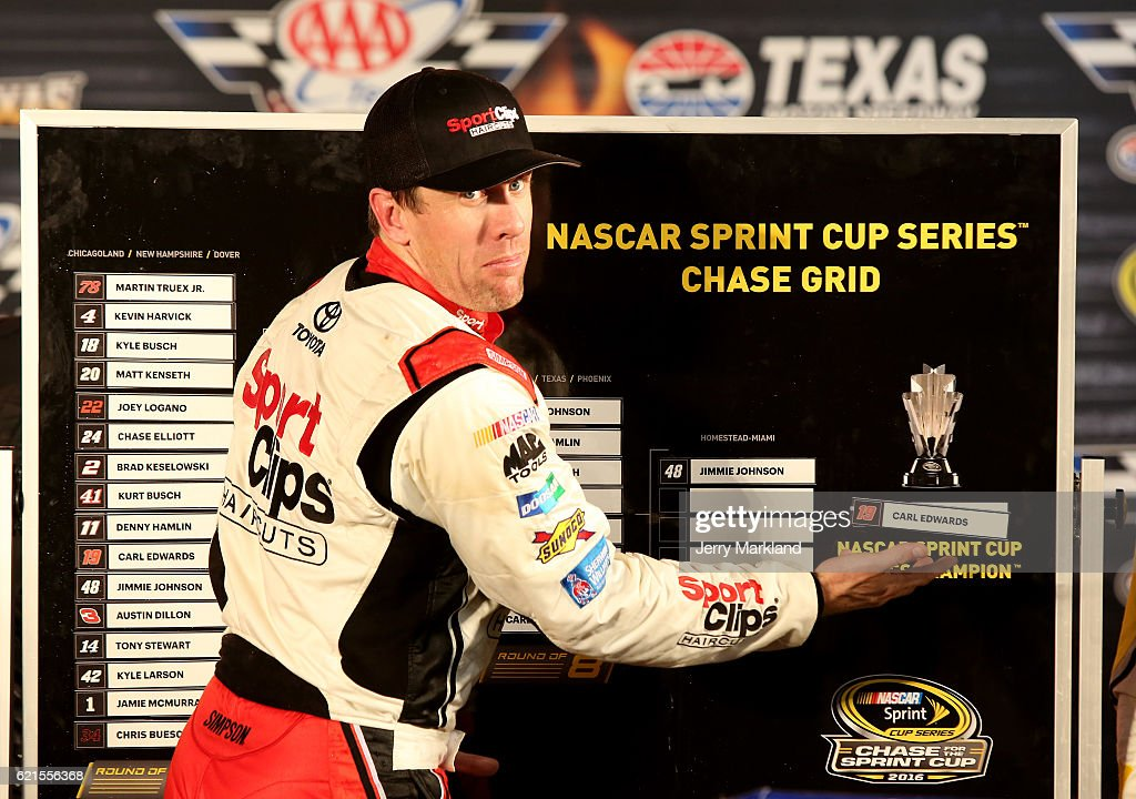Carl Edwards, driver of the #19 Sport Clips Toyota, jokes around by putting his name on the Chase Grid as the 'NASCAR Sprint Cup Series Champion' in Victory Lane after winning the rain-shortened NASCAR Sprint Cup Series AAA Texas 500 at Texas Motor Speedway on November 6, 2016 in Fort Worth, Texas.
