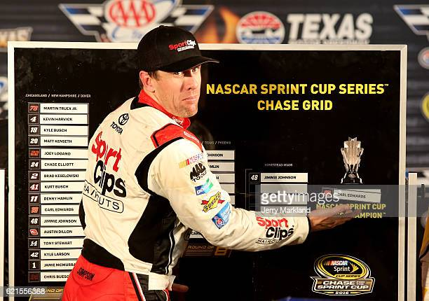 Carl Edwards driver of the Sport Clips Toyota jokes around by putting his name on the Chase Grid as the 'NASCAR Sprint Cup Series Champion' in...