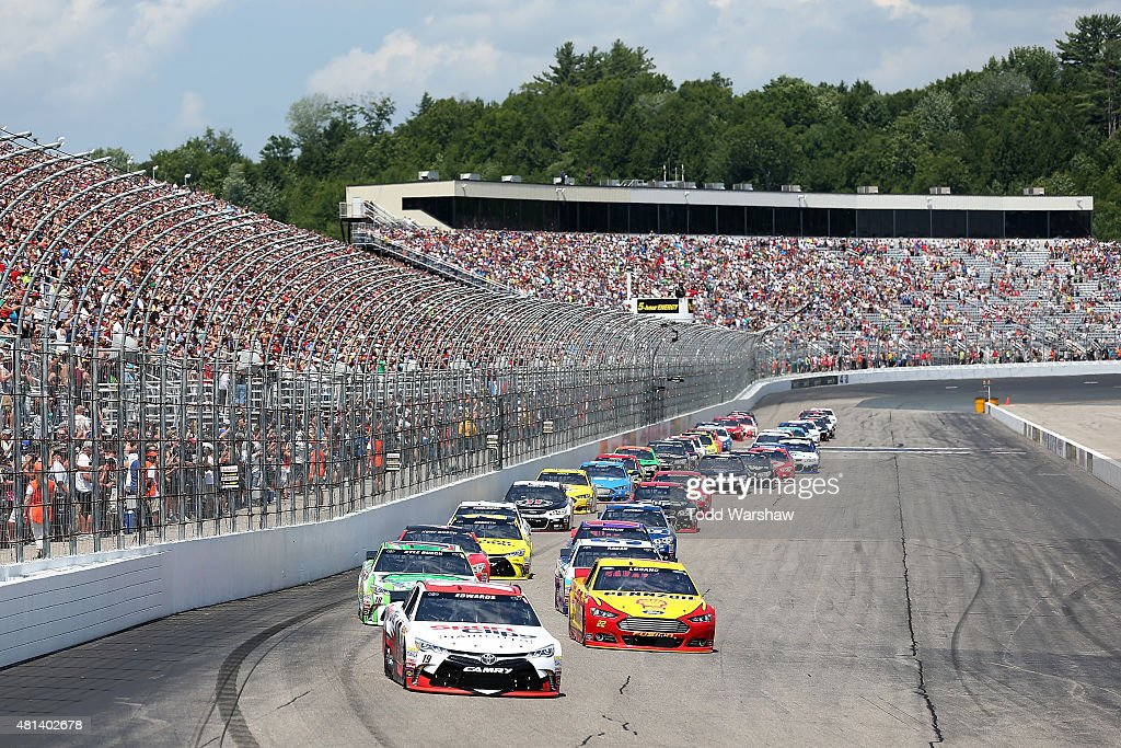 Carl Edwards driver of the Sport Clips Toyota leads the field at the start of the NASCAR Sprint Cup Series 5Hour ENERGY 301 at New Hampshire Motor...