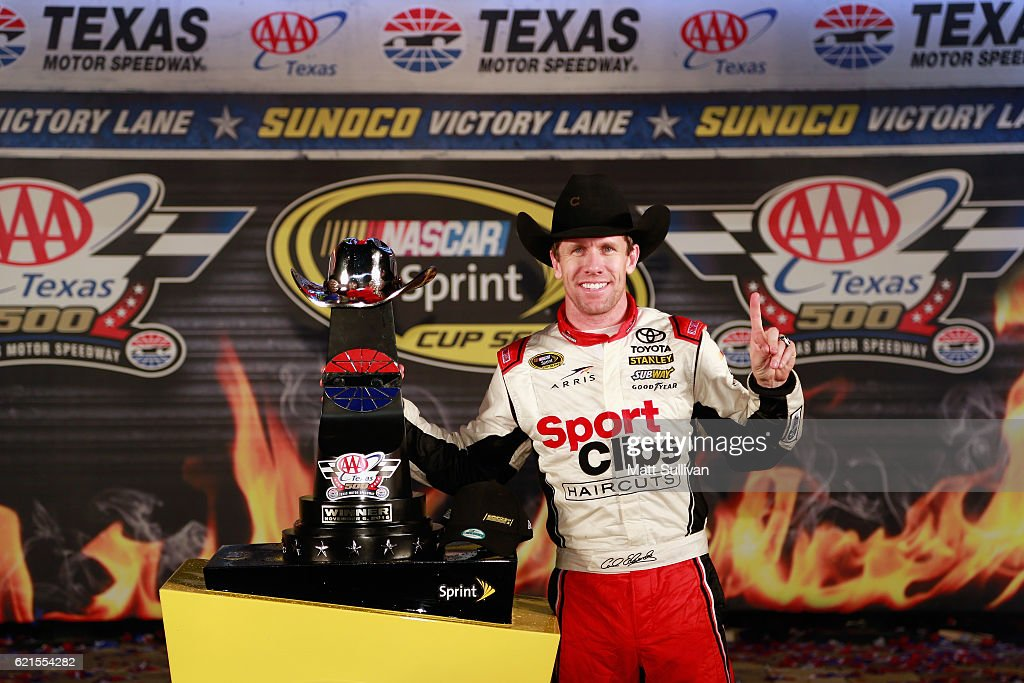 Carl Edwards, driver of the #19 Sport Clips Toyota, poses in Victory Lane after winning the rain-shortened NASCAR Sprint Cup Series AAA Texas 500 at Texas Motor Speedway on November 6, 2016 in Fort Worth, Texas.