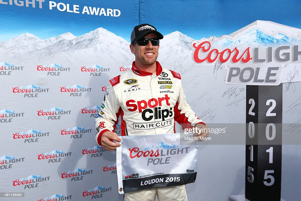 Carl Edwards, driver of the #19 Sport Clips Toyota, poses with the Coors Light Pole Award after qualifying for pole position for the NASCAR Sprint Cup Series 5-Hour Energy 301 at New Hampshire Motor Speedway on July 17, 2015 in Loudon, New Hampshire.