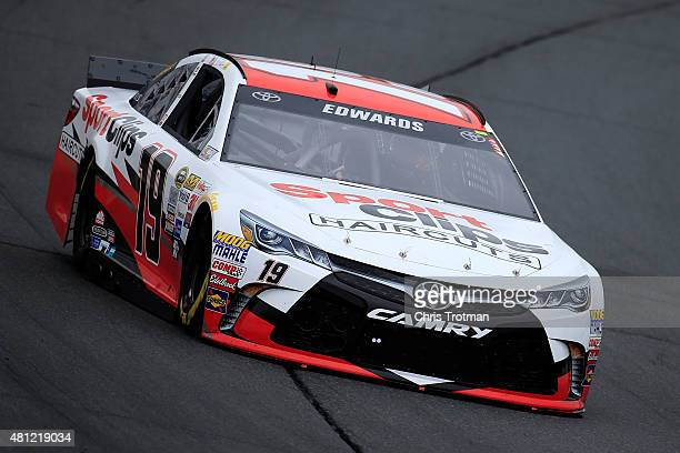 Carl Edwards driver of the Sport Clips Toyota practices for the NASCAR Sprint Cup Series 5Hour Energy 301 at New Hampshire Motor Speedway on July 18...