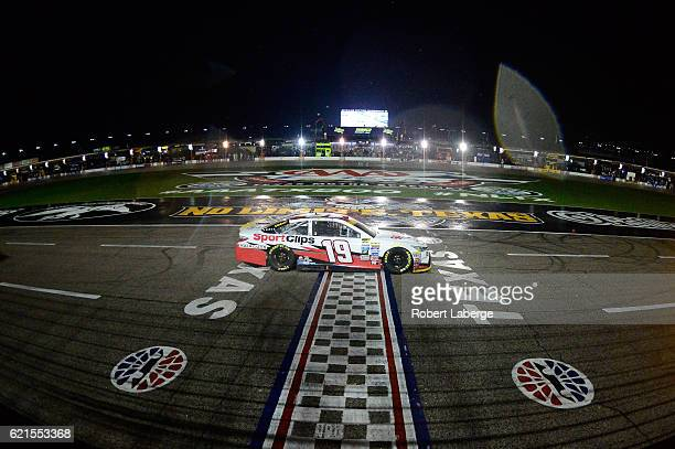 Carl Edwards driver of the Sport Clips Toyota races under caution during the NASCAR Sprint Cup Series AAA Texas 500 at Texas Motor Speedway on...