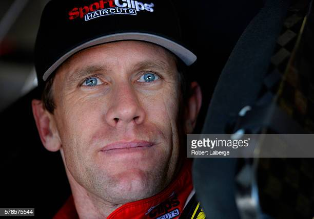 Carl Edwards driver of the Sport Clips Toyota sits in his car during practice for the NASCAR Sprint Cup Series New Hampshire 301 at New Hampshire...