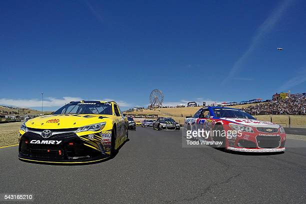 Carl Edwards driver of the Stanley Toyota and AJ Allmendinger driver of the Ralph's/Kingsford Chevrolet lead the field on parade laps prior to the...