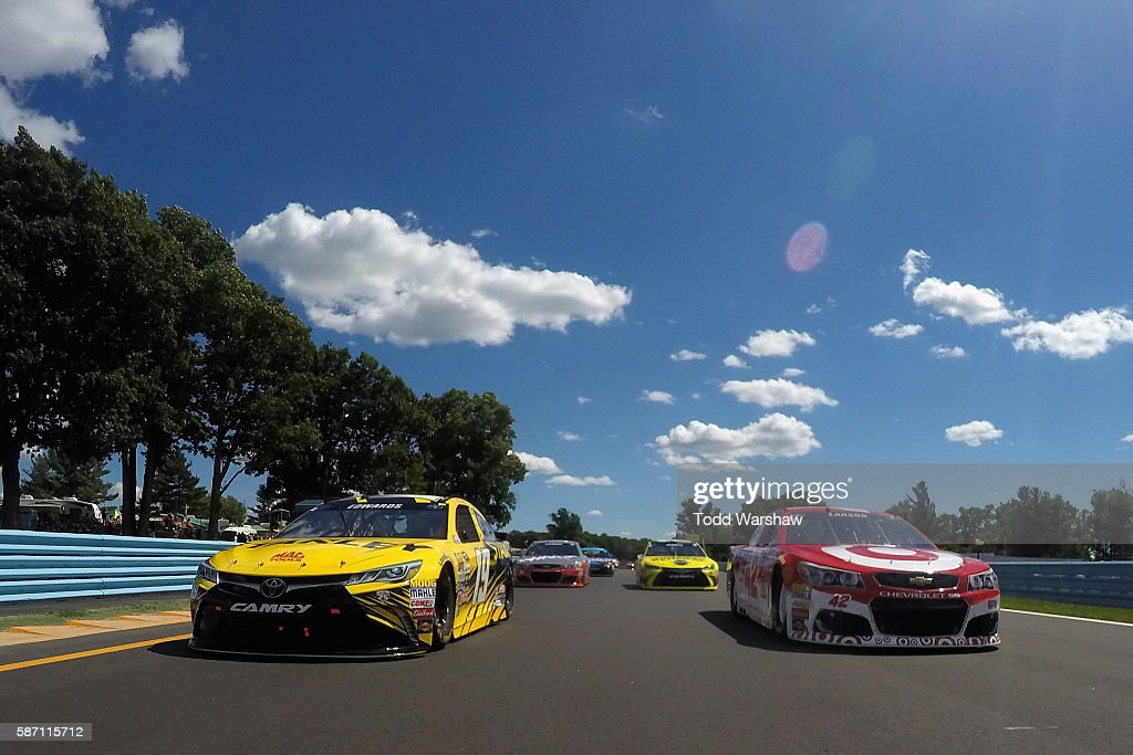 Carl Edwards, driver of the #19 Stanley Toyota, and Kyle Larson, driver of the #42 Target Chevrolet, lead the field during parade laps prior to the NASCAR Sprint Cup Series Cheez-It 355 at Watkins Glen International on August 7, 2016 in Watkins Glen, New York.