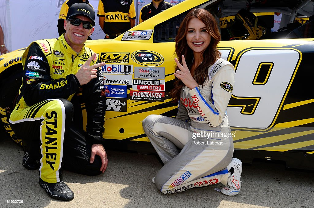 <a gi-track='captionPersonalityLinkClicked' href=/galleries/search?phrase=Carl+Edwards&family=editorial&specificpeople=193803 ng-click='$event.stopPropagation()'>Carl Edwards</a>, driver of the #19 Stanley Toyota, and Miss Coors Light Amanda Mertz pose with the Coors Light Pole Award after qualifying for the pole position for the NASCAR Sprint Cup Series Crown Royal Presents the Jeff Kyle 400 at the Brickyard at Indianapolis Motor Speedway on July 25, 2015 in Indianapolis, Indiana.