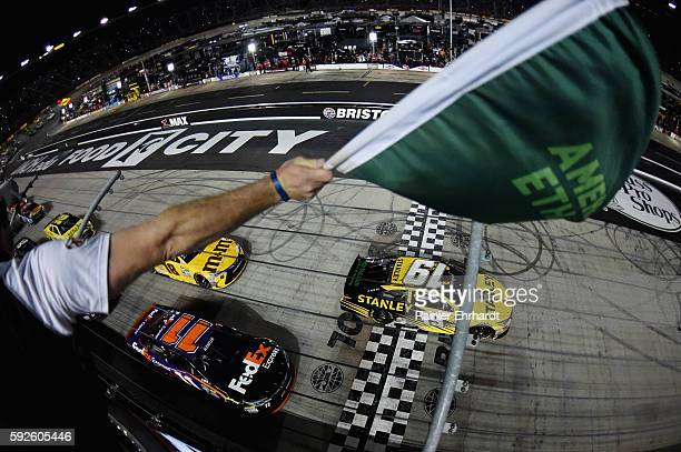 Carl Edwards driver of the Stanley Toyota leads the field past the green flag to start the NASCAR Sprint Cup Series Bass Pro Shops NRA Night Race at...