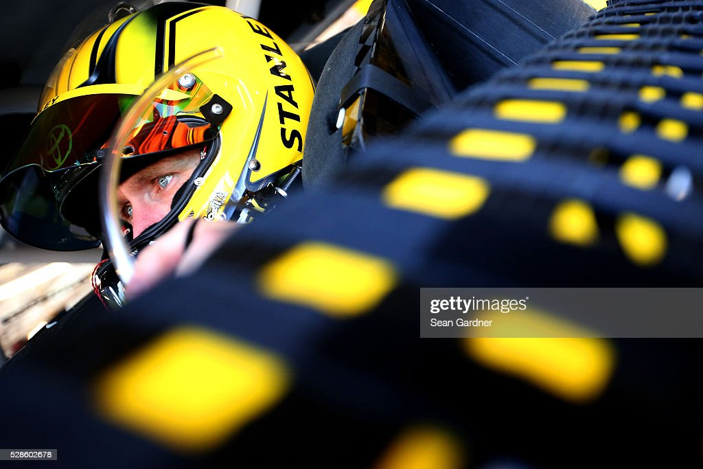 Carl Edwards, driver of the #19 Stanley Toyota, looks on during practice for the NASCAR Sprint Cup Series Go Bowling 400 at Kansas Speedway on May 6, 2016 in Kansas City, Kansas.