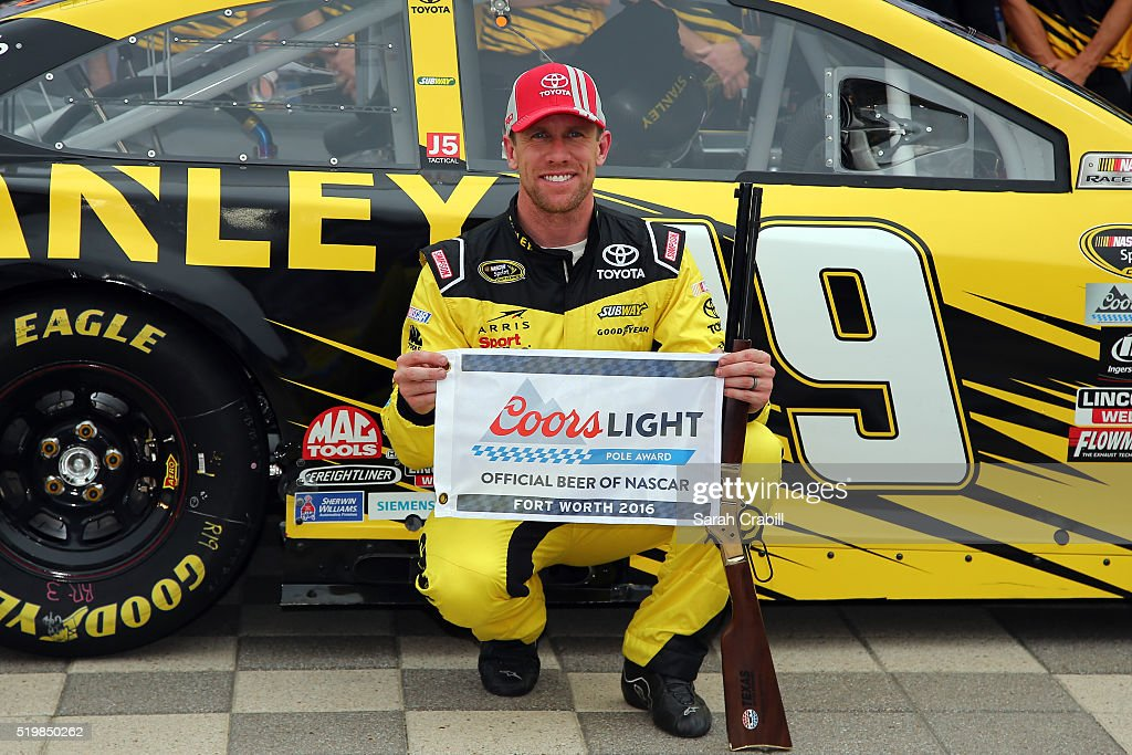 Carl Edwards, driver of the #19 Stanley Toyota, poses with the Coors Light Pole Award after qualifying for the pole position for the NASCAR Sprint Cup Series Duck Commander 500 at Texas Motor Speedway on April 8, 2016 in Fort Worth, Texas.