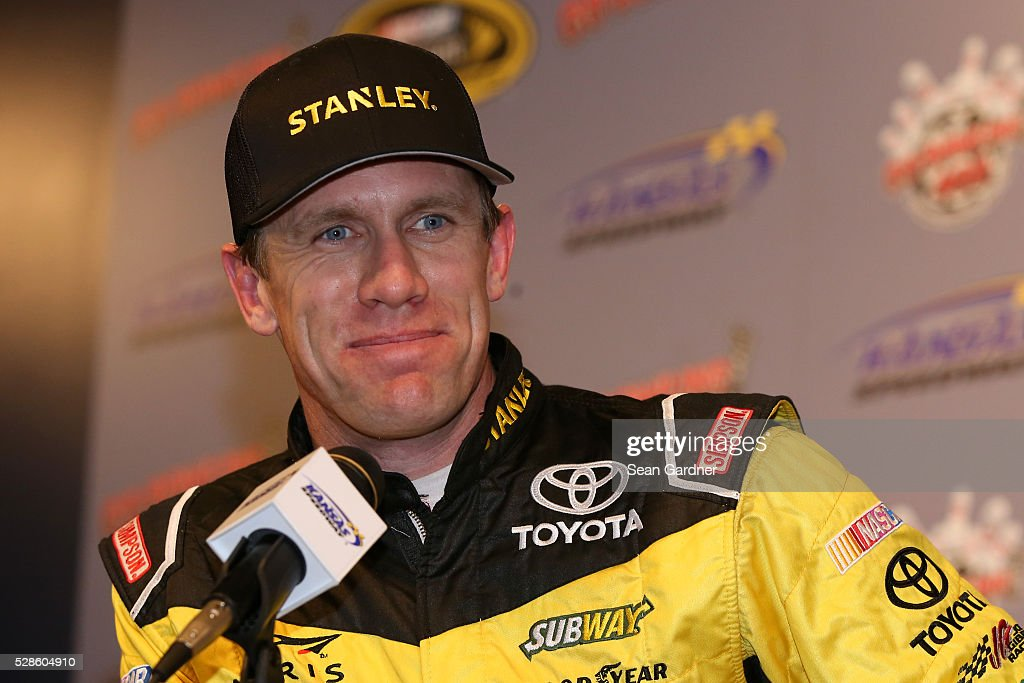 Carl Edwards, driver of the #19 Stanley Toyota, speaks to the media prior to practice for the NASCAR Sprint Cup Series Go Bowling 400 at Kansas Speedway on May 6, 2016 in Kansas City, Kansas.
